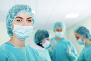 young-female-surgeon-with-medical-team-scaled-1.jpg